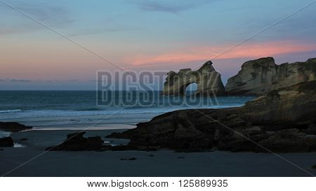 Sunset at Wharariki Beach. Beautiful landscape on the South Island of New Zealand.