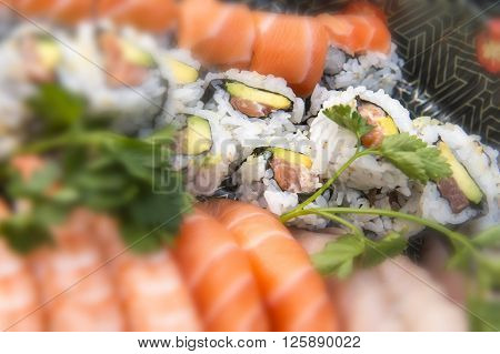 Assorted Japanese Sushi On A Black Plate