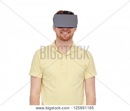 3d technology, virtual reality, entertainment and people concept - happy young man with virtual reality headset or 3d glasses