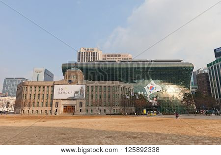 SEOUL SOUTH KOREA - MARCH 14 2016: Seoul Metropolitan Library (1926) and modern Seoul City Hall building (2008) in Seoul Korea. Library building serves as City Hall in 1945-2008