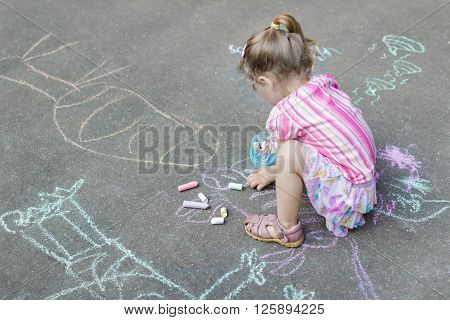 Sidewalk chalk drawings of little Caucasian girl wearing pink ruffle skirt with floral pattern