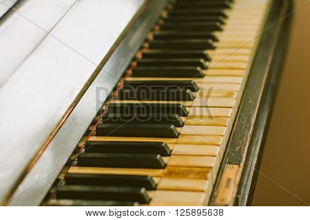 Old rusty piano keyboard, selective focus, instrument detail