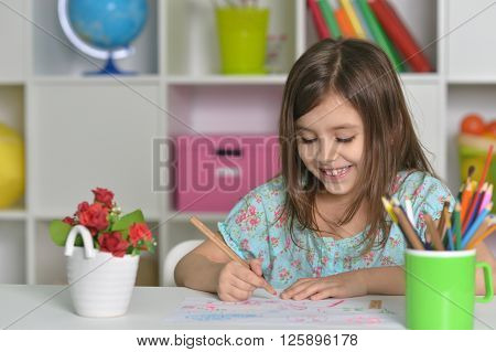 Portrait of Little girl drawing at home