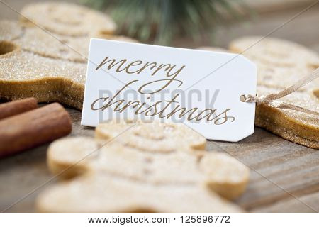 Defocused Image Of Gingerbread Candies With Merry Christmas Tag