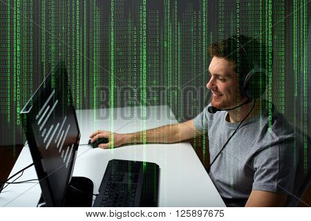 technology, gaming, entertainment, let's play and people concept - happy young man in headset with pc computer playing game at home and streaming playthrough or walkthrough video