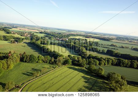 Cultivated field from above. Aerial view of meadows and cultivated fields. Birds view. Arable land