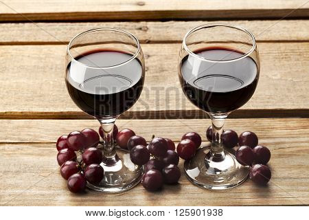 High Angle View Of Wine Glass And Grapes