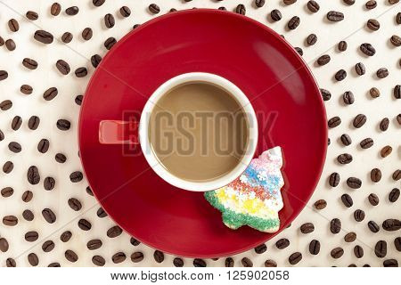 Hot Chocolate With Christmas Cookies In Red Saucer With Coffee Beans