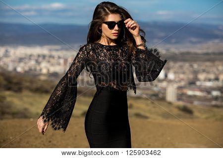Beautiful Girl Model Brunette In A Black Dress And Sunglasses