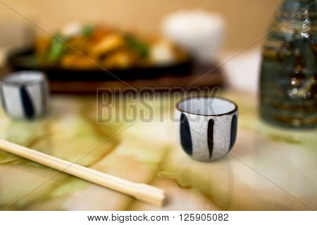 Marble Table With Japanese Dinner And Saki