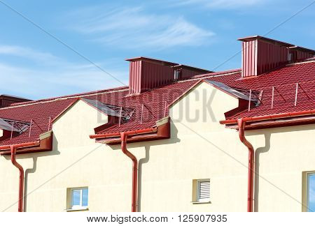 Part Of A House With Roof And Gutter