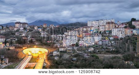 The city of Sochi, view residential houses and automotiv tonnel. Russia