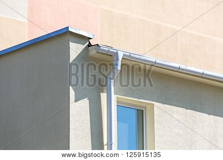 White Drainpipe On Wall