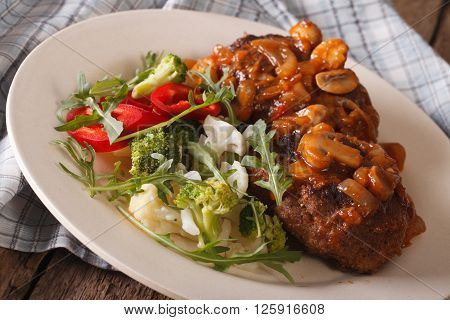 Salisbury Steak With Vegetable Salad Close-up On A Plate. Horizontal