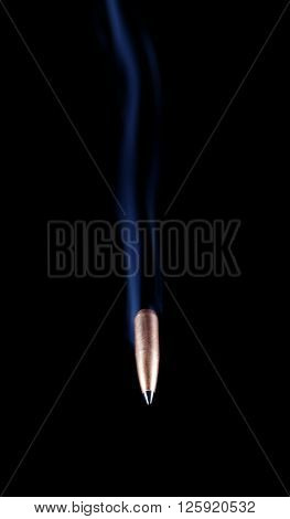 Bullet with a polymer tip and copper coating coming at the viewer