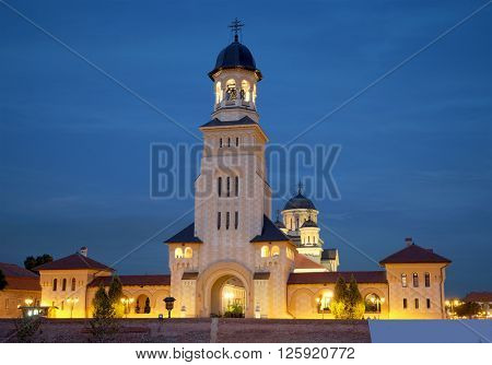 bell tower of the Coronation Cathedral in Carolina Citadel of Alba Iulia at night, Romania