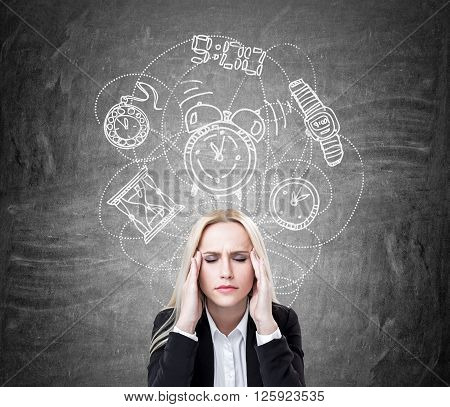 Lack of time concept with stressed businesswoman on concrete background