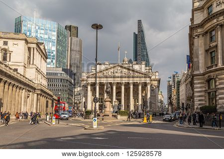 LONDON UK - 25TH MARCH 2015: The Bank of England in the City of London showing buildings people and traffic