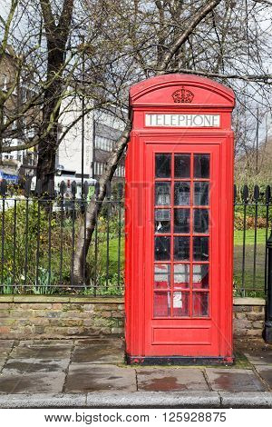LONDON UK - 26TH MARCH 2015: A red telephone box in central London during the day.