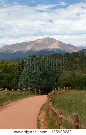 The view of Pikes Peak from a paved trail in the central garden at Garden of the Gods