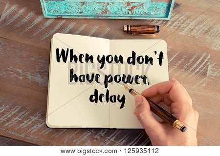 Handwritten quote When you don't have power delay, as inspirational concept image