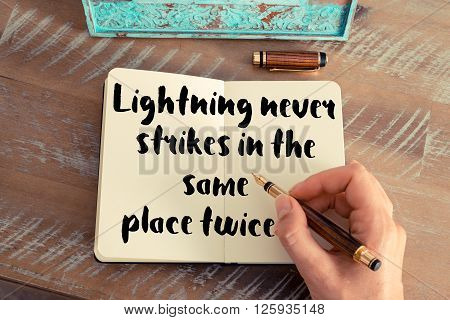 Handwritten quote Lightning never strikes in the same place twice, as inspirational concept image