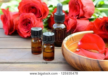 essential oils with red roses for garden spa