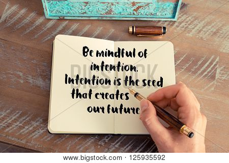 Handwritten quote Be mindful of intention. Intention is the seed that creates our future, as inspirational concept image