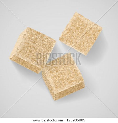 Three cubes of brown sugar with shadow on grey background