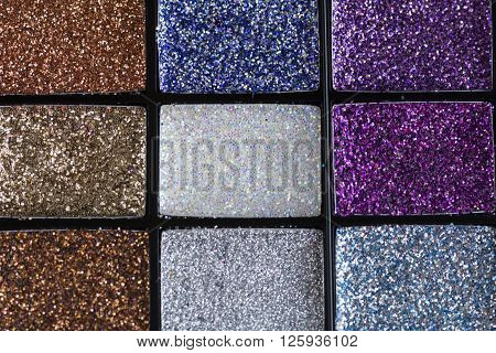 Selective Focus Beautiful Colors Of Makeup Glittering Background