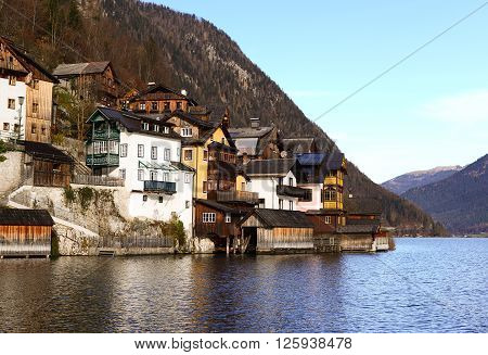 View of Hallstatt old town village on river bank between lake and mountain