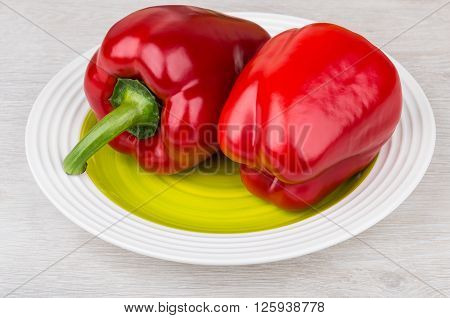 Two Re Bulgarian Peppers In Green Glass Plate