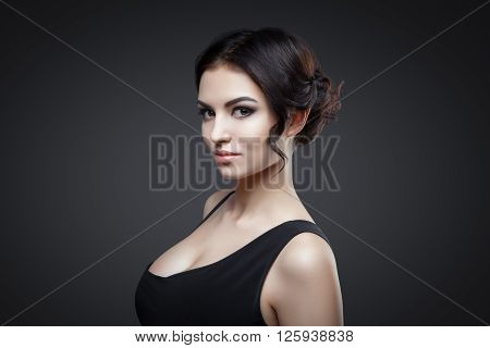 Beautiful woman with curly hair and evening make-up. Fashion art photo. Luxury woman.