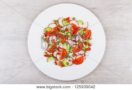 Salad From Miscellaneous Vegetables In White Glass Plate On Table