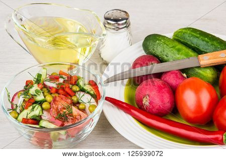 Vegetable Salad, Jug Of Oil And Plate With Miscellaneous Vegetables