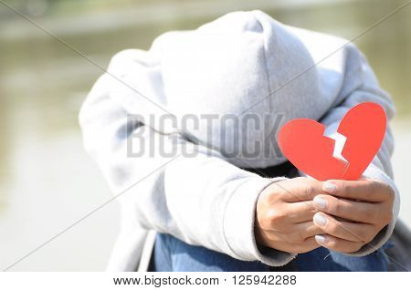 Female Offer ing Broken Heart in Hands
