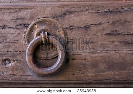 Close-up view of an ancient Tuscan iron knocker