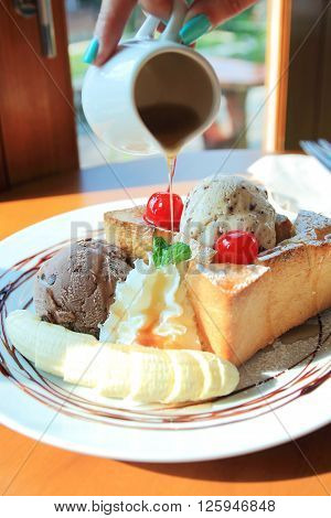 Honey toast with banana maple syrup and ice cream