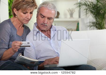 Senior couple making online purchases