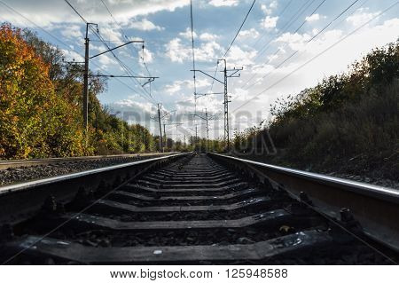 receding into the distance railway in autumn