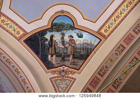 STITAR, CROATIA - AUGUST 27: Adam and Eve in Paradise, fresco in the church of Saint Matthew in Stitar, Croatia on August 27, 2015