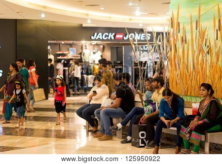 Delhi, India - 10th April 2016: People relaxing inside shopping malls in Delhi Gurgaon. With the heatwave in the city malls have become the hang out place of choice for people