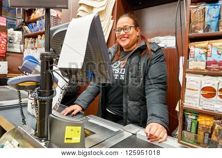NEW YORK - CIRCA MARCH 2016: cashier in West Side Market.  West Side Market is a supermarket at Broadway, New York
