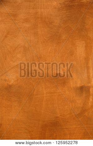 close up of dark brown veneer board