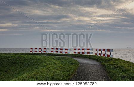 Road fence on the bike path near the sea.