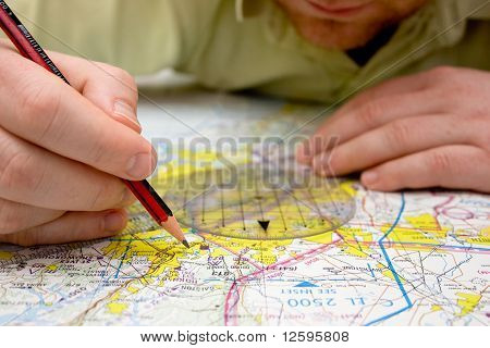 Pilot Plotting A Course On A Map