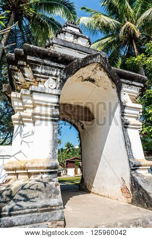Entrance to Wat Aham, Luang Prabang, Laos.The wat lies adjacent to Wat Wisunalat and that monastery's uniquely impressive That Makmo the Watermelon Stupa