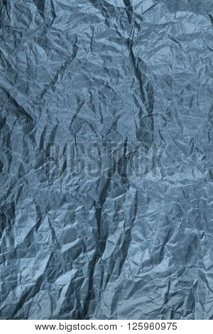 sheet of crumpled silver paper background. crumpled paper texture dark.