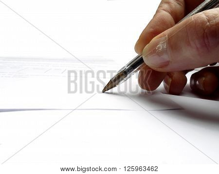Hand with pen signing an imperceptible text of paper