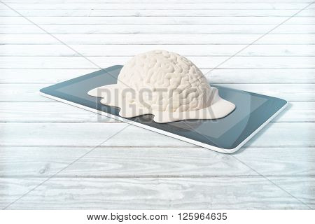 Mental degradation concept with brain melting on tablet placed on light wooden desktop. 3D Rendering